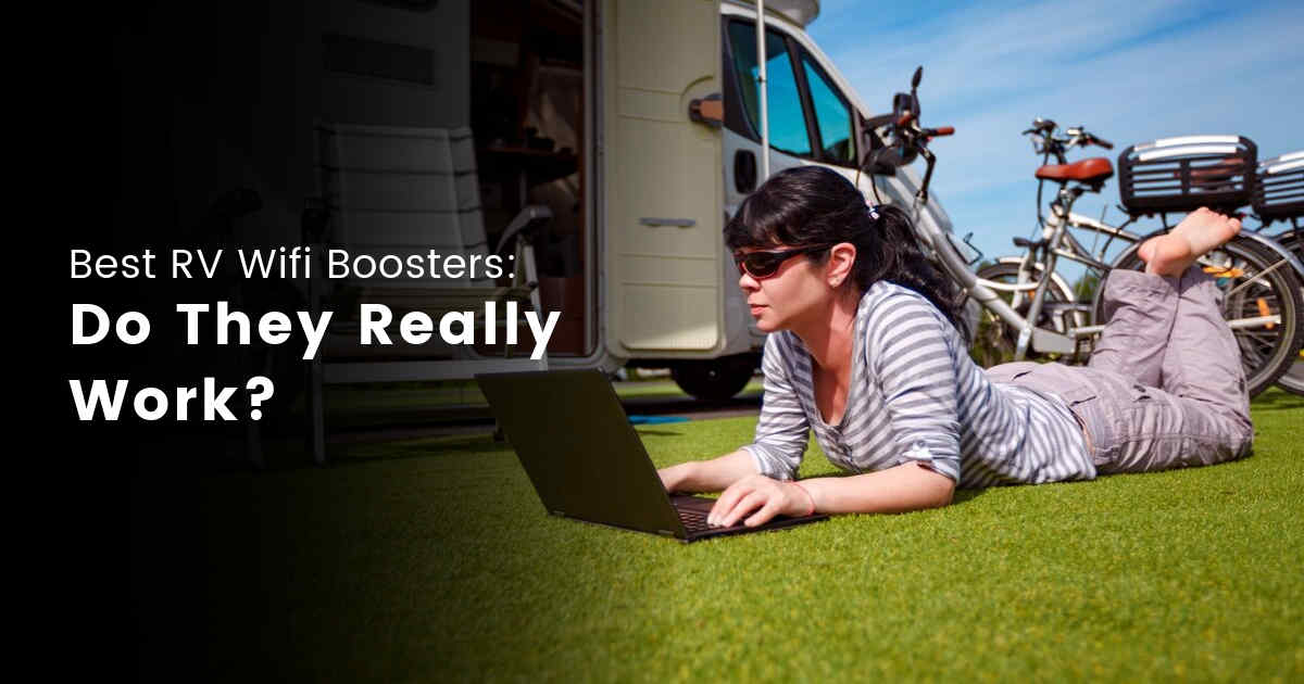 Woman working on laptop sitting outside the RV on the grass