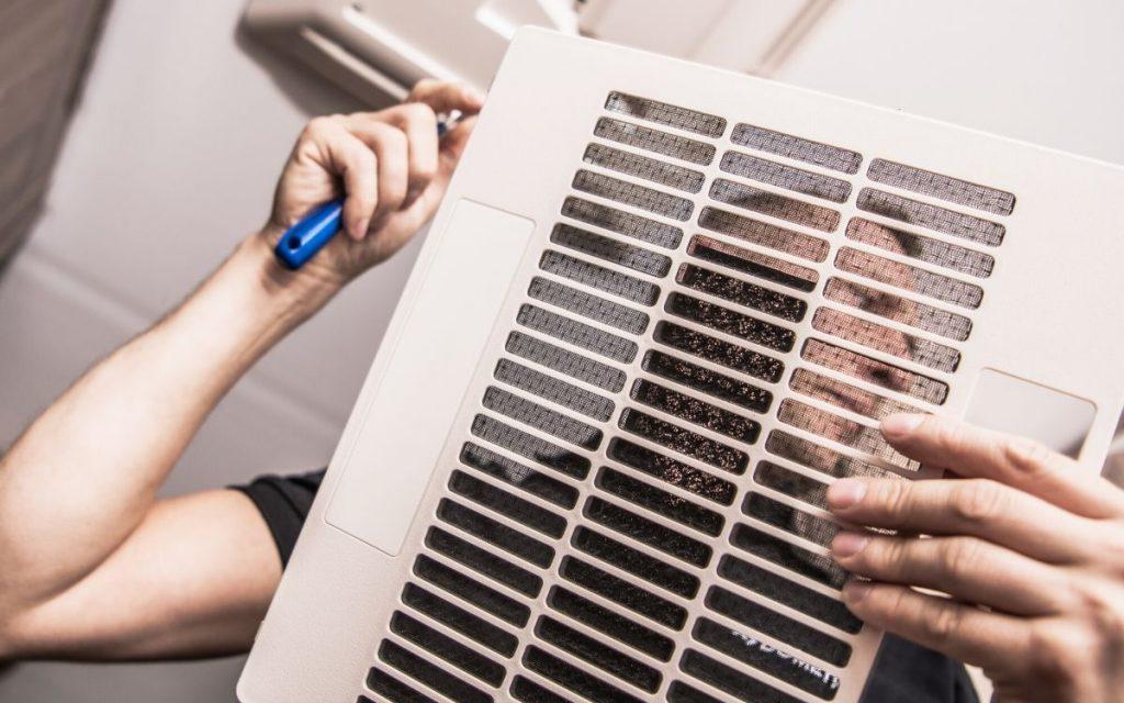 Technician removing an RV AC filter