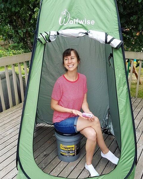 Bucket toilet in a pop up tent for use in a camper or camping