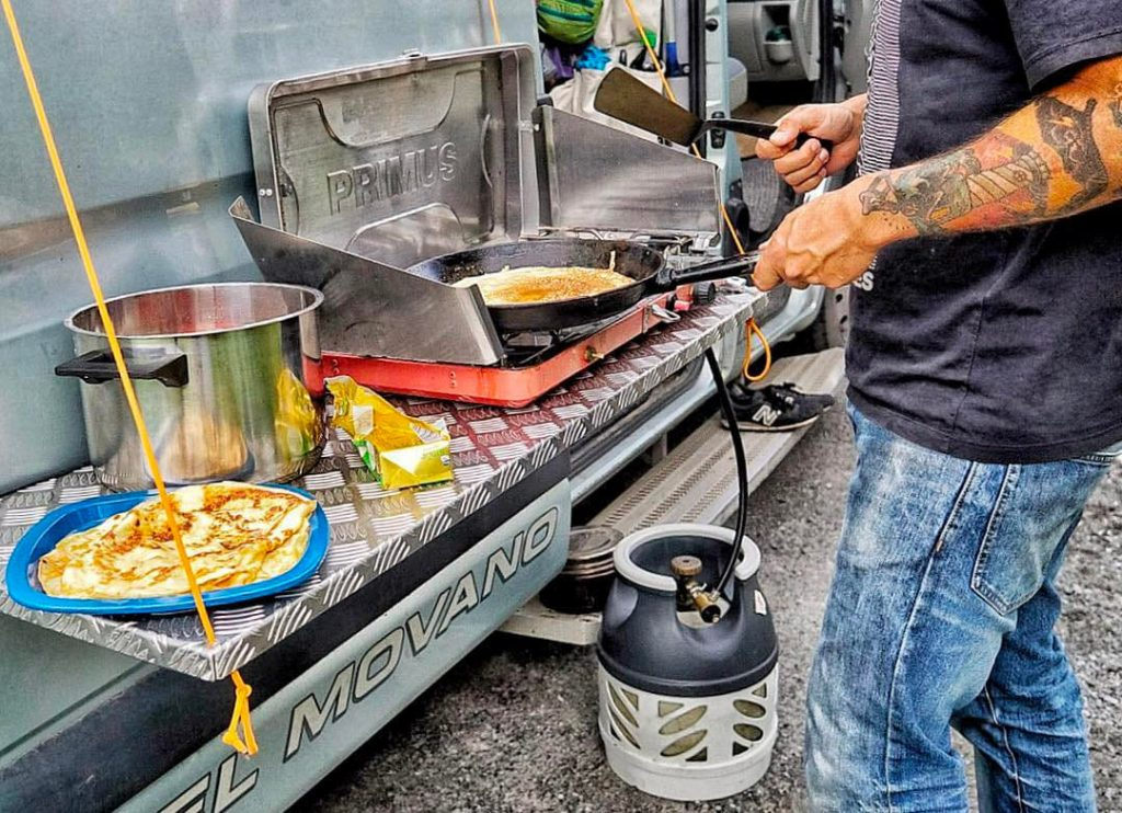 Cooking outdoors with a propane portable stove