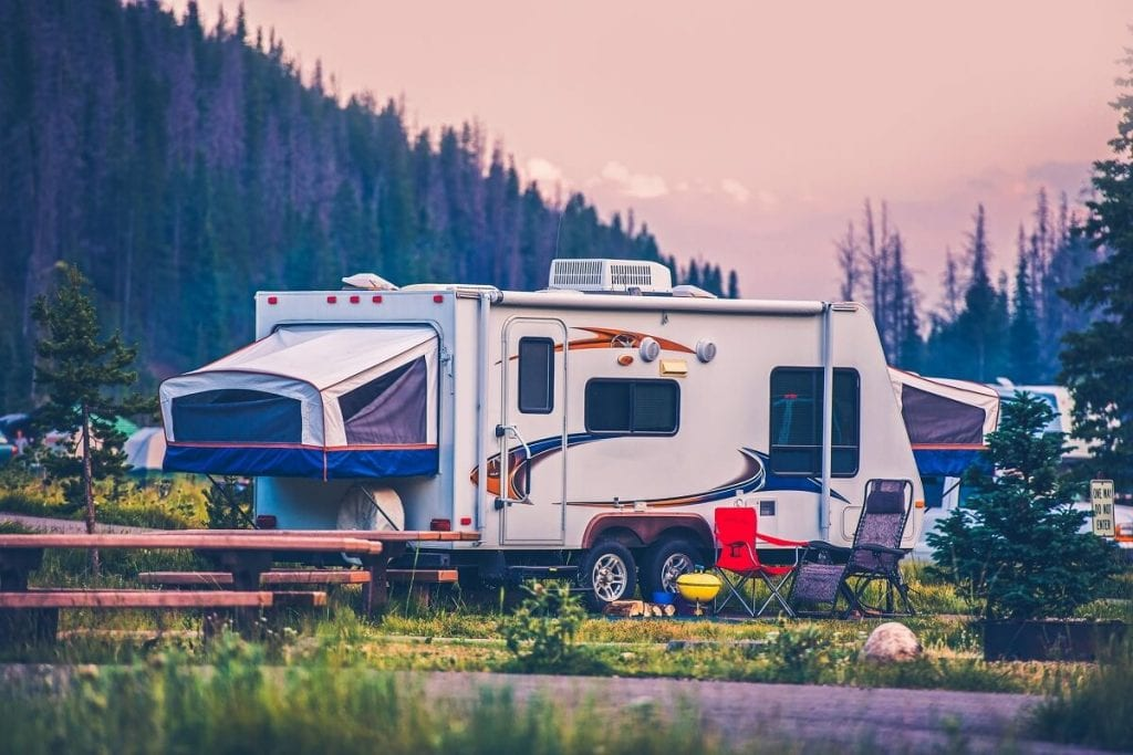 A travel trailer parked at an RV campsite.