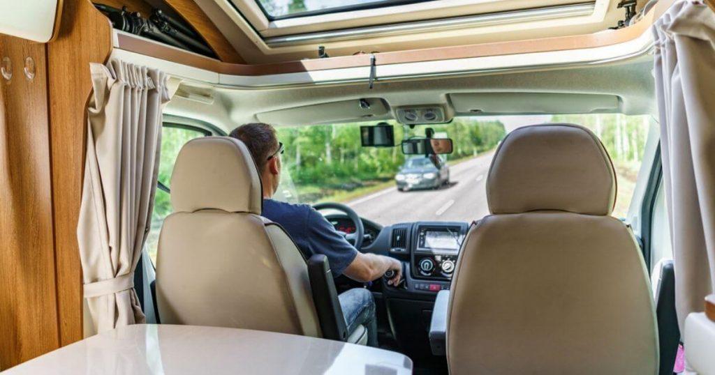 Man driving a camper van rv motorhome