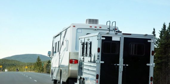RV Camper Towing a Trailer